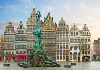 medieval Brabo fountain and old guildhalls houses at Grote Markt square, Antwerpen, Belgium